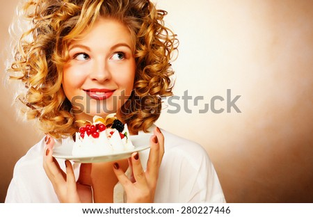 beautiful smiling young blond woman with a cake - stock photo
