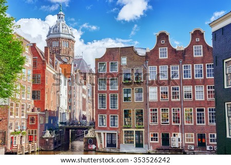 """Beautiful views of the streets, ancient buildings, people, embankments of Amsterdam - also call """"Venice in the North"""". Netherlands - stock photo"""