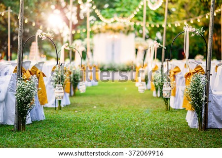 Beautiful  Wedding ceremony in garden at sunset - stock photo