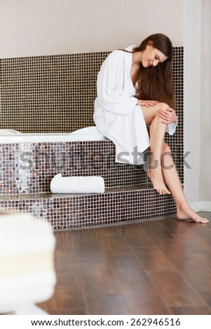 Beautiful Woman Cares About Legs After Bath. Long Woman Legs. - stock photo