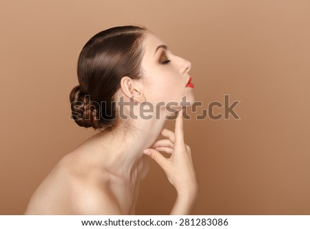 Beautiful Woman Touching her neck.  - stock photo