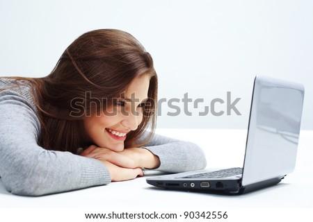 Beautiful  Woman Using Laptop. Online Shopping - stock photo