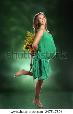 beautiful woman with autumn bouquet.waiting for child. beautiful sunflowers. bright emotions, beautiful smile - stock photo