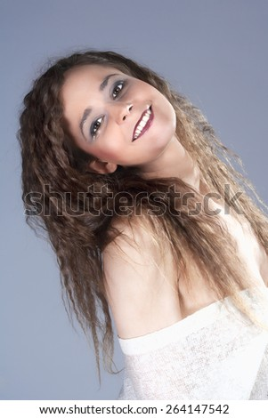 Beautiful Woman with Brown Curly Hair Smiling - stock photo