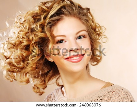 beautiful woman with curly hair, young and happy - stock photo