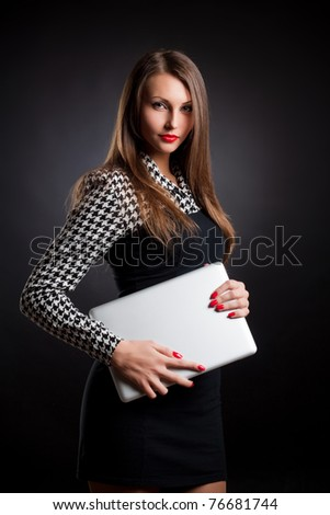 beautiful young girl in a business style with a Notebook - stock photo