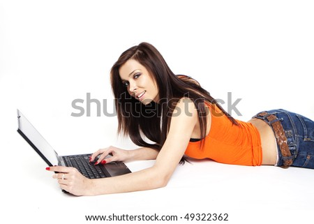 beautiful young girl with a computer - stock photo