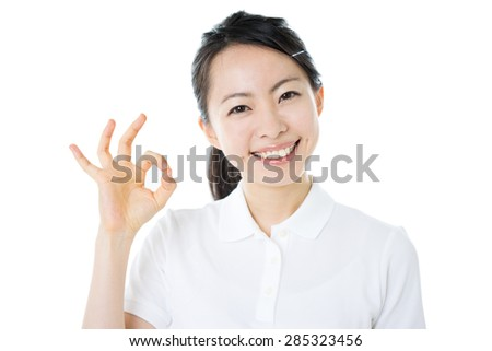 beautiful young woman showing OK gesture isolated on white background - stock photo