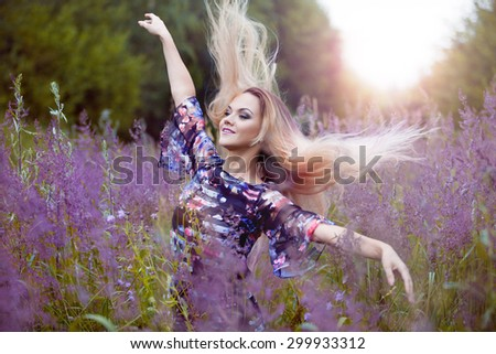 Beauty  girl alone with nature, freedom concept  , blond women in dress  on a meadow - stock photo