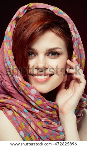 beauty portrait of a smiling woman in a headscarf