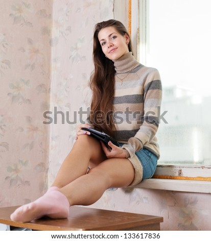 beauty woman reads e-book in home - stock photo