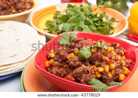 beef chili with beans,corns and cilantro - stock photo
