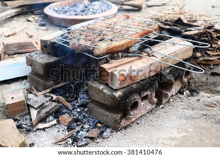 Beef on barbecue stove with flame in-Thailand.