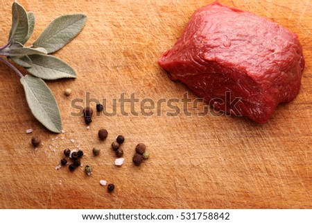 beef with herbs, garlic and spices on a cutting board