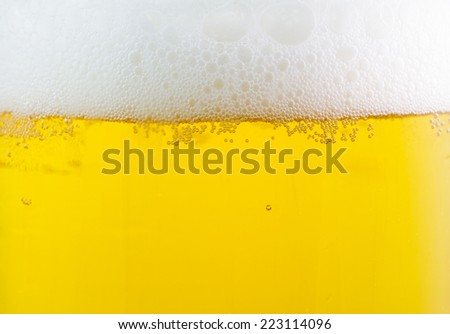 beer with foam background close up   - stock photo
