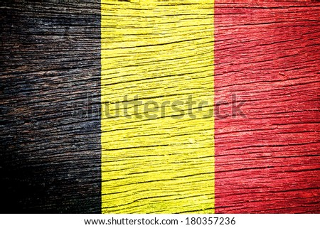 Belgium flag on old wood texture  - stock photo