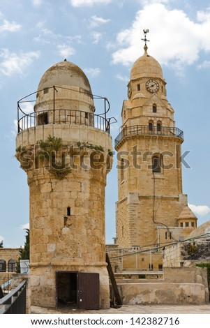 Bell-Tower of Church of Dormition and old Minaret on Mount Zion - stock photo