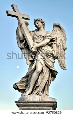 Bernini's marble statue of angel with cross, Saint Angelo Bridge in Rome, Italy (evening time) - stock photo