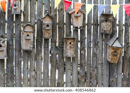 Birdhouses on the fence as decoration.