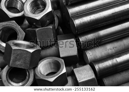 Black and white image of screws and bolts pile - stock photo