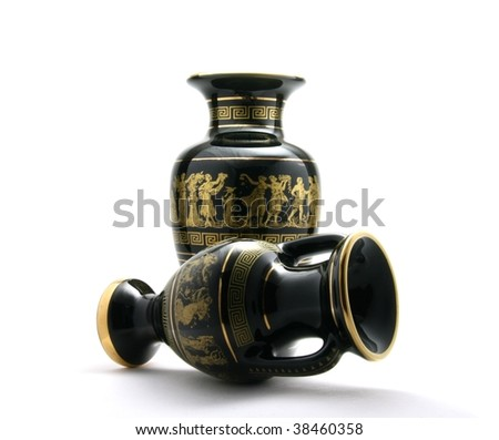 2 black greek vases with gold ornament isolate in white