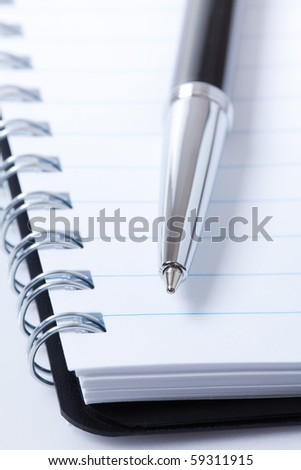 black pen and notebook - stock photo