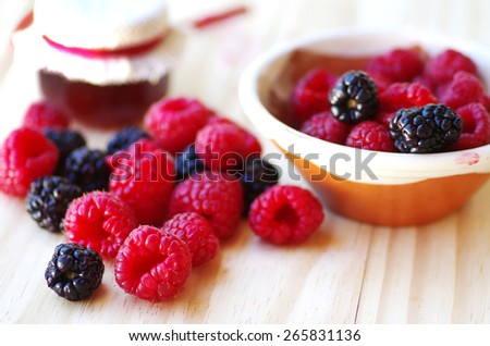blackberry and raspberry on table - stock photo
