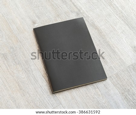 Blank black leather cover book template on white grey color wooden table background: Empty business notebook cover on light gray colour wood floor: Closed school student binder note pad on desk  - stock photo