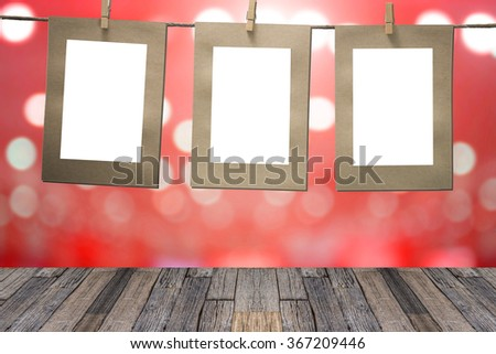 blank instant photos hanging on the clothesline.  - stock photo