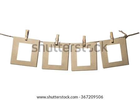blank instant photos hanging on the clothesline. Isolated on white background. - stock photo