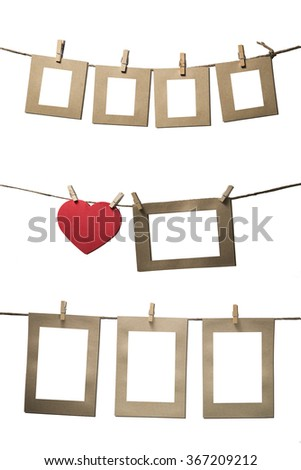 blank instant photos hanging on the clothesline with red heart vintage color - stock photo