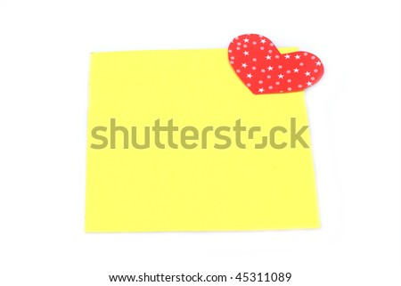 blank yellow note with heart magnet - stock photo