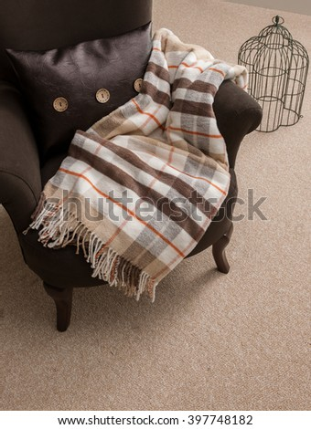 blanket armchair with pillow and cage - stock photo