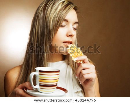 blond woman with coffee and cookies.