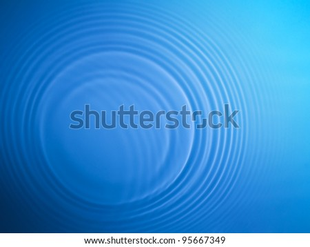 Blue circle water ripple background - stock photo