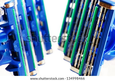 Blue shaving razors isolated on a white background