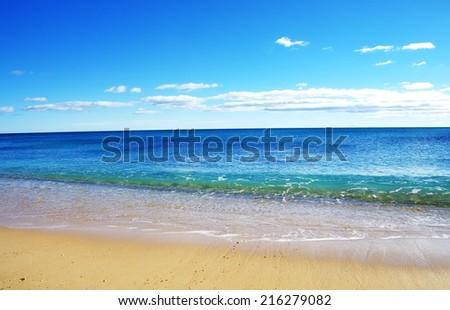 Blue wave on the beach  - stock photo