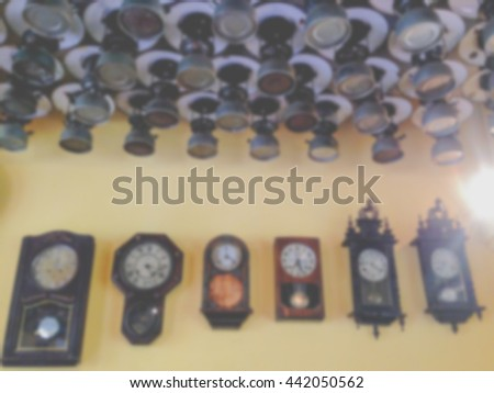 blur image background, many vintage kerosene oil lantern lamp and Vintage Wood Clock - stock photo