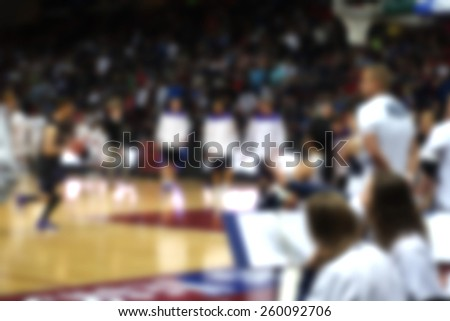 blurred background of basketball players                           - stock photo