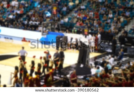 blurred background of sports arena crowd watching basketball game                               - stock photo