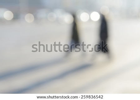 blurred background, pedestrians - stock photo
