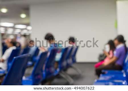 Blurred background : Traveler at airport terminal blur background with bokeh light,waiting for  flight
