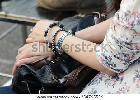 blurred women hand hold bag on leg - stock photo