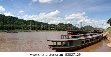boats on the Mekong river lao - stock photo