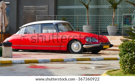 BODRUM / TURKEY �  22 JANUARY 2016:  Vintage luxury  red car Citroen DS standing at front of the restaurant entrance located at Bodrum Turkey - stock photo