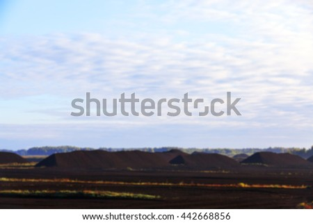 bog and the field on which the production is carried out in black peat mining, industry, defocus