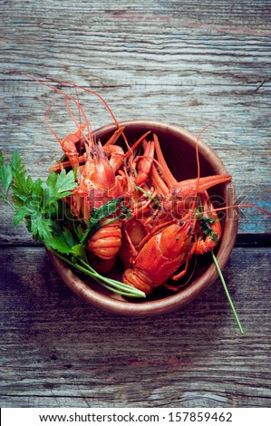 Boiled crayfish in a wooden bowl - stock photo