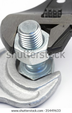 bolt and wrench close up shallow dof - stock photo