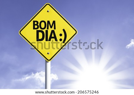 """Bom Dia"" (In portuguese - Good Morning) road sign with sun background"