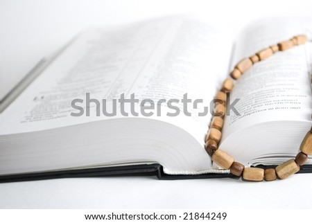 Book and Rosary on white